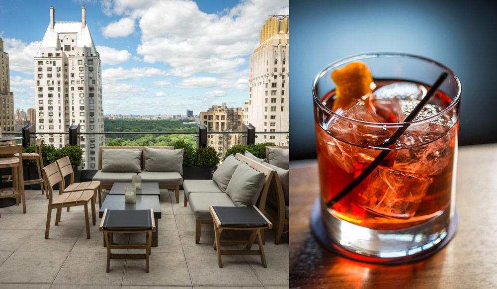vaso de cocktail y mueblos del rooftop-bar the roof