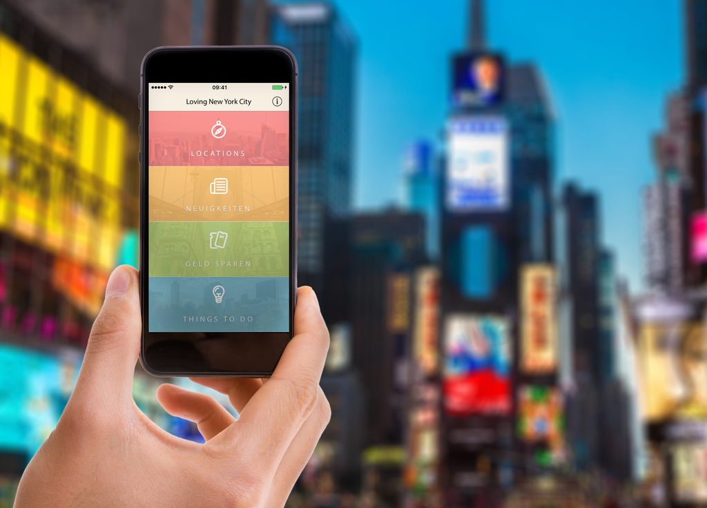 Hand holding mobile with black screen on Times Square background