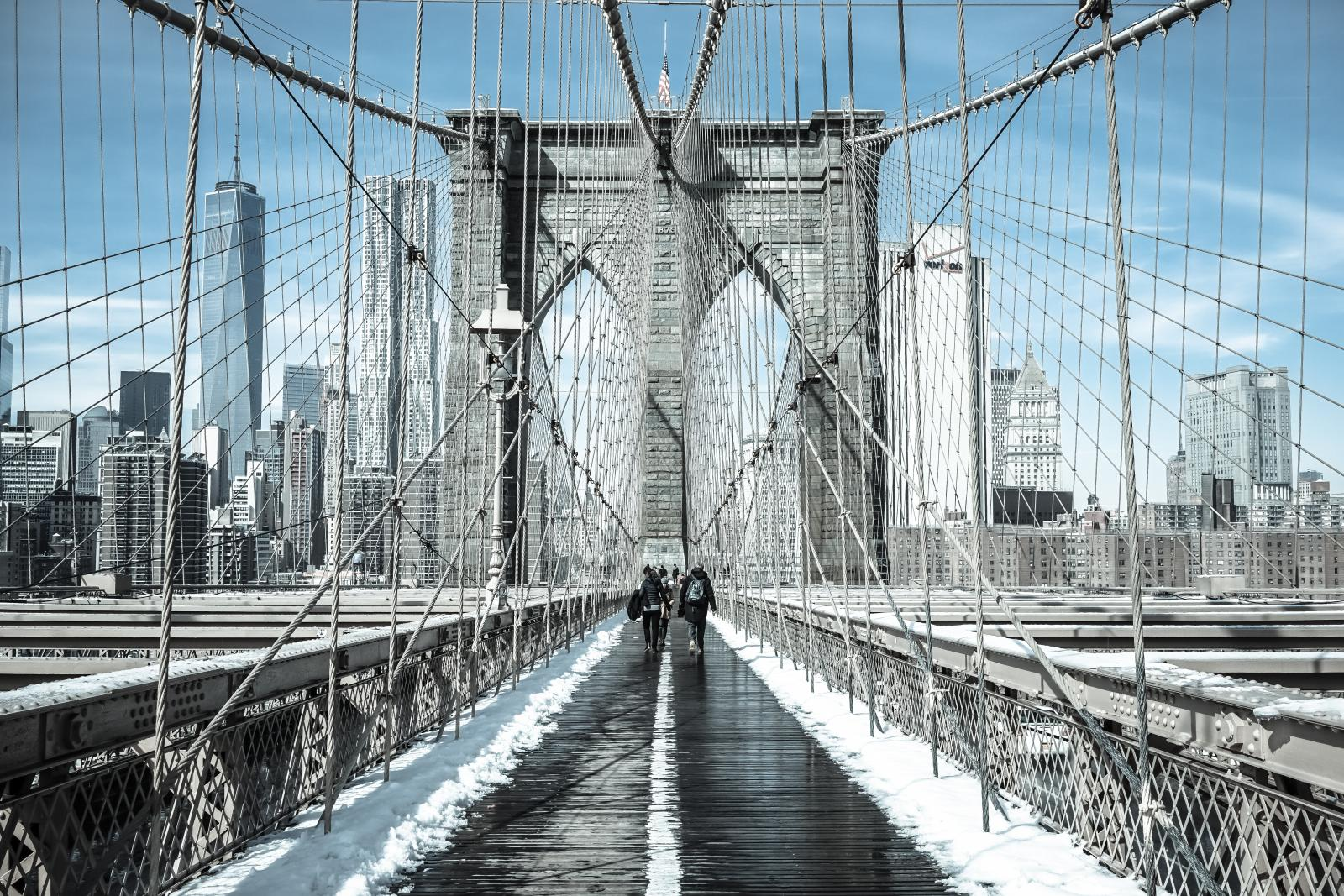 Winter in New York / Pedestrians cross snow-covered Brooklyn Bri